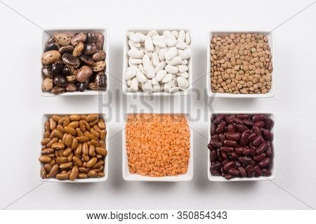 Different Food Ingredients From Legume Family Like Beans And Lentils On White Background.