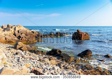 Rocky Sea Coast In The Morning. Calm Sunny Weather