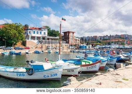 Sozopol, Bulgaria - Sep 09, 2019: Fishing Boats In Port On A Sunny Day. Town On The Hill In The Dist