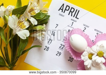 April 2020 Calendar, Cute Pure White Easter Eggs And White Flowers On Yellow Background. April 2020