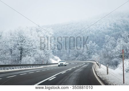Car Travel In Highway In Winter. Traveling By Car On The Road. Car In Highway In Winter Landscape. T