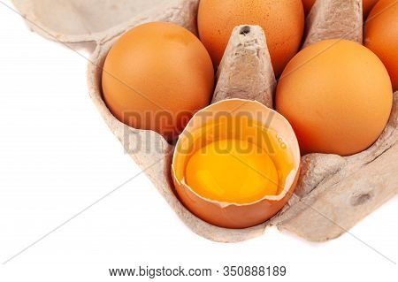 Egg Chicken Eggs. Top View Of An Open Gray Box With Brown Eggs Isolated On A White Background. One E