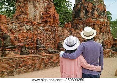 Tourist Couple Admiring A Group Of Headless Buddha Images Remains In Wat Mahathat Ancient Temple In