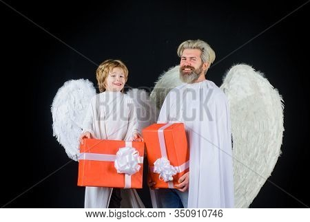 Valentines Angels With Gift Box. Father And Son Angels. Happy Father In Angel Costume With Little So