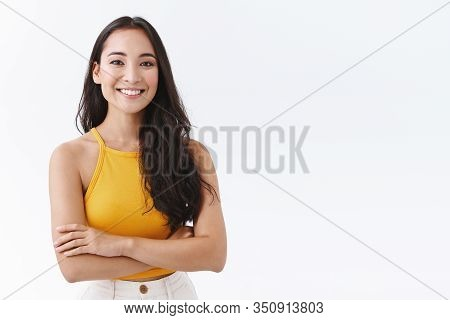 Confident, Attractive Young Outgoing Asian Woman In Yellow Top, Smiling Friendly And Happy As Cross