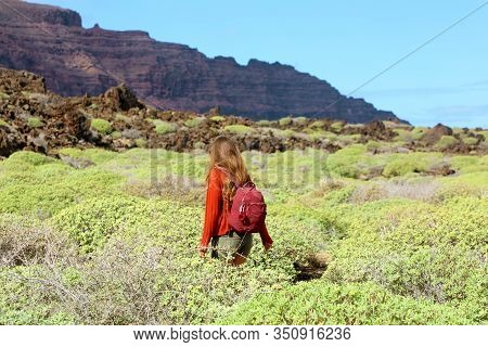 Spring Time Hike. Back View Of Girl Exploring The Northern Of The Island Of Lanzarote. Young Female