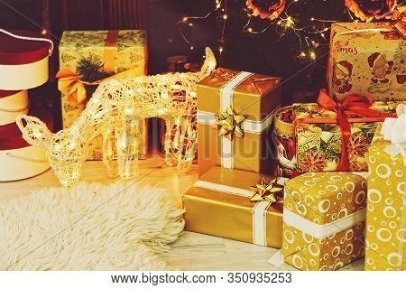 Christmas Gift Boxes And Deer Near Christmas Fir-tree. New Year. Christmas.