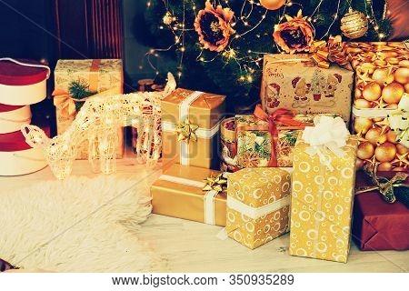 Christmas Gift Boxes And Deer Near Christmas Fir-tree Taken Closeup. New Year. Christmas.