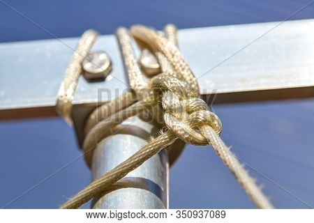 A Rope Is Knotted To A Strut Of Aluminum.