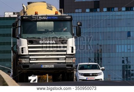 Bucharest, Romania - October 17, 2018: A Rusu Beton Concrete Mixer Scania Truck Is In Traffic In Buc