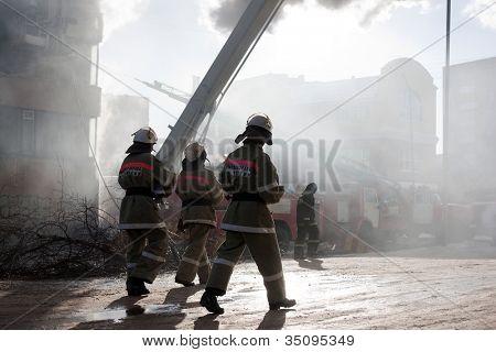 Burning fire, smoke, firefighters' emergency service