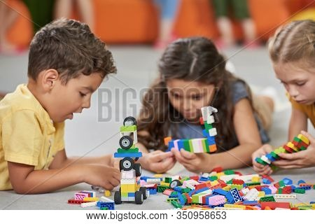 31.07.2017 - Kyiv, Ukraine. Little Boys And Girls Playing With Block Toys In Playroom. Kids Playing