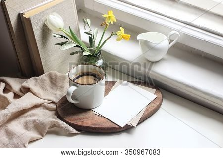 Cozy Easter Spring Still Life. Greeting Card Mockup Scene. Cup Of Coffee, Books, Wooden Cutting Boar
