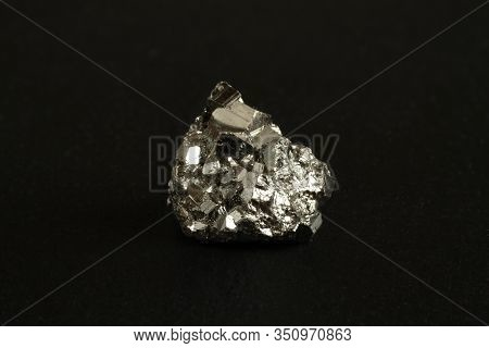Mineral Pyrite On The Black Stone Plate