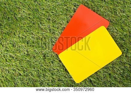 Soccer Sports Referee Yellow And Red Cards On Grass Background - Penalty, Foul Or Sports Concept, To