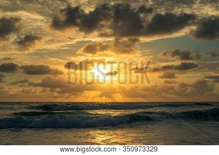Summer Seaside Scenery Beach Sunset, Sunrise Background With Golden Clouds And Sun Rays. Summer Seas