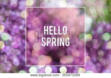 Spring Background Design With Purple Blue Lilac Flowers And Bokeh Lights With Text Hello Spring. Mod