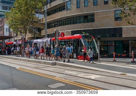 Sydney, Australia - January 26, 2020: Modern Red Tramway On George Street In Sydney Cbd With People