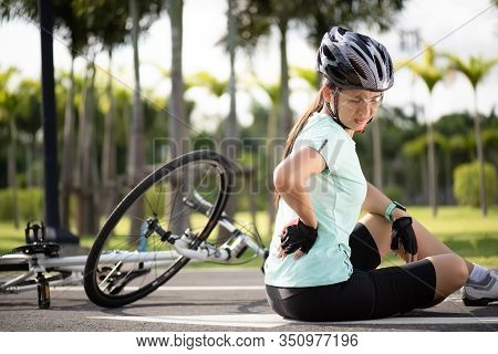 Bike Injuries. Woman Cyclist Fell Off Road Bike While Cycling. Bicycle Accident, Injured Back.
