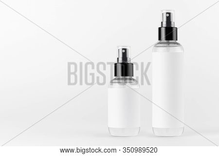 Tall, Low Transparent Spray Dispenser Bottle For Cosmetics With White Label On White Background, Moc