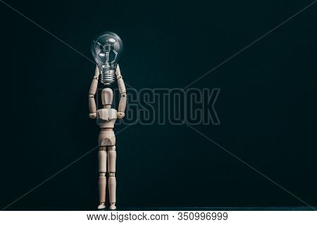 Bright Mind Conceptual Composition. Inspiration Idea Knowledge. Wooden Manikin With Bulb Over Head.