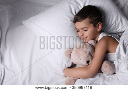 Little Boy Sleeping With Teddy Bear At Home. Bedtime