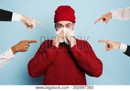 Boy Caught A Cold Is Accused Of Infecting The Virus. Studio On Cyan Background