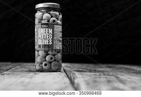 Perth, Scotland - 11 November 2019: Jar Of Green Pitted Olives In Brine