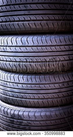 Set Of Summer Car Tires Isolated. Tire Stack Background. Car Tyre Protector Close Up. Black Rubber T