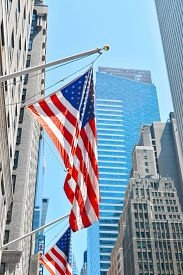 Americans Flag On The Building On One Of New York Street I Manhattan, Usa. Vertical Photo