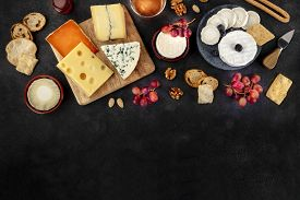 Cheese Assortment Design Template. Blue Cheese, Soft Cheese, Wine, Grapes, Shot From The Top On A Bl