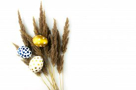White, Golden And Blue Easter Eggs With Dry Flowers Flat Lay Isolated On White Background Top View,