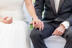 Wedding Groom And Bride Couple Hold Hands At Marriage Ceremony. Elegant Husband With Dark Suit And S