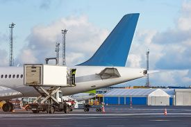 Airplane Tail View- Service Before Flights, Service Machine For Loading