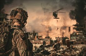 Military Forces Between Smoke And Ruins Roping To Destroyed City And The Soldier Looks At Them