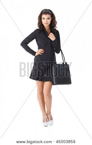 Attractive young woman in black, looking at camera.