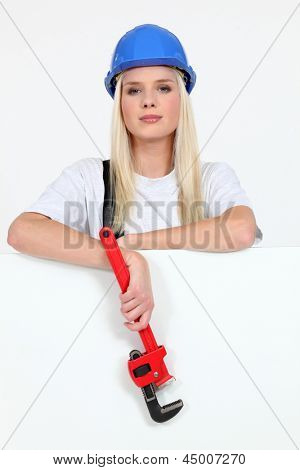 Beautiful female laborer in dungarees