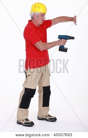 Tradesman using a power tool