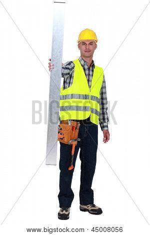 Tradesman holding up a steel girder
