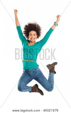 Portrait Of Girl Jumping In Joy Isolated Over White Background