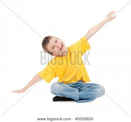 boy in yellow t-shirt simulates flight