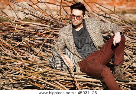 Sexy Fashion Man Model Dressed Elegant Holding A Bag Posing Outdoor