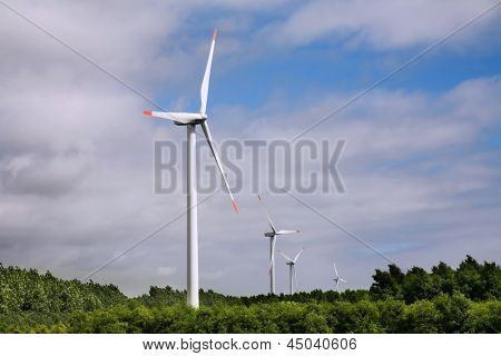 Wind turbines in the field generating electricity