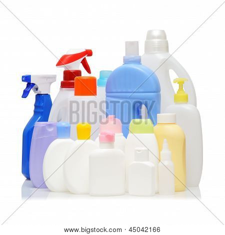 Assorted empty detergent bottles on white background. poster