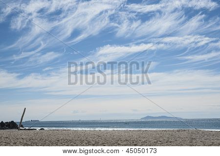 Whispy clouds in sky