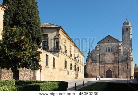 UBEDA, SPAIN - JANUARY 7: People on the Vazquez de Molina Square in Ubeda, Spain on January 7, 2013. The parador hotel in the center of picture is one of the oldest in Spain