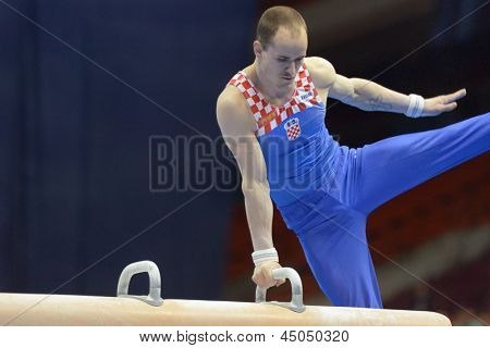 MOSCOW, RUSSIA - APRIL 20: Filip Ude, Croatia performs exercise on pommel horse in final of 5th European Championships in Artistic Gymnastics in Moscow, Russia on April 20, 2013