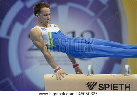 MOSCOW, RUSSIA - APRIL 20: Saso Bertoncelj, Slovenia performs exercise on pommel horse in final of 5th European Championships in Artistic Gymnastics in Moscow, Russia on April 20, 2013