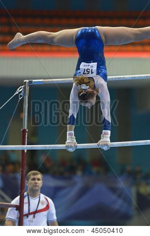 MOSCOW, RUSSIA - APRIL 20: Maria Paseka, Russia performs exercise on uneven bars in final of 5th European Championships in Artistic Gymnastics in Moscow, Russia on April 20, 2013