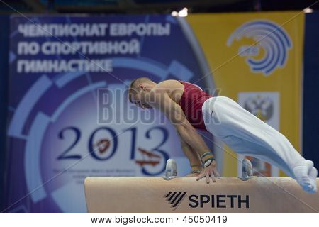 MOSCOW, RUSSIA - APRIL 20: Krisztian Berki, Hungary performs exercise on pommel horse in final of 5th European Championships in Artistic Gymnastics in Moscow, Russia on April 20, 2013